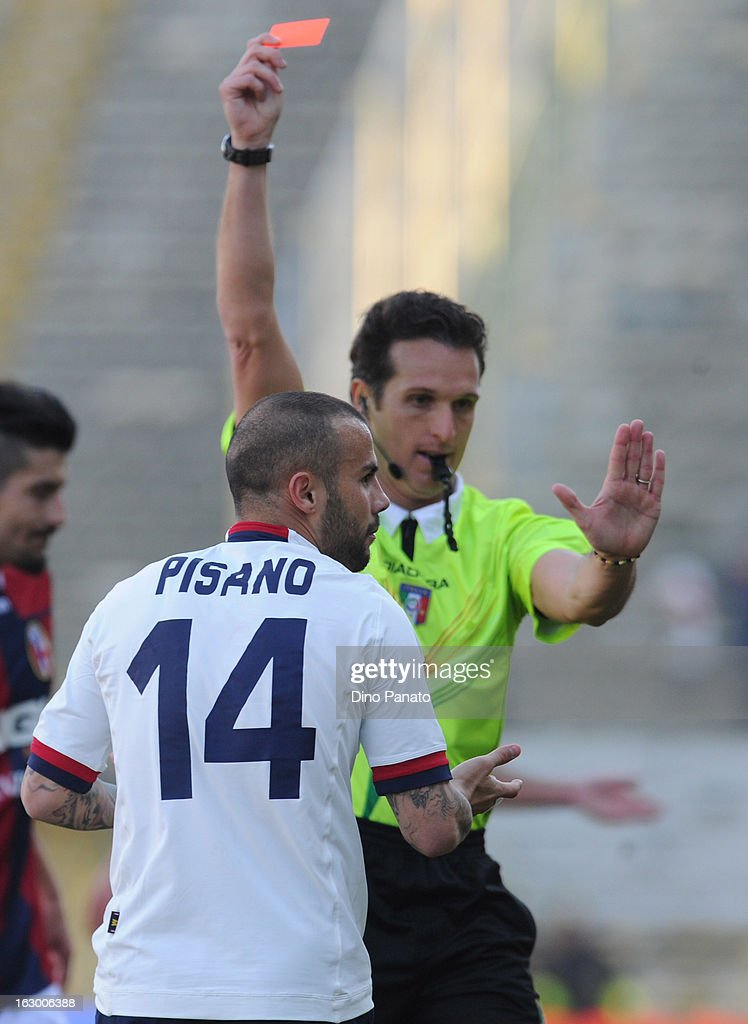 Referee Luca Banti (R) shows red card to <a gi-track='captionPersonalityLinkClicked' href=/galleries/search?phrase=Francesco+Pisano&family=editorial&specificpeople=2366269 ng-click='$event.stopPropagation()'>Francesco Pisano</a> during the Serie A match between Bologna FC and Cagliari Calcio at Stadio Renato Dall'Ara on March 3, 2013 in Bologna, Italy.