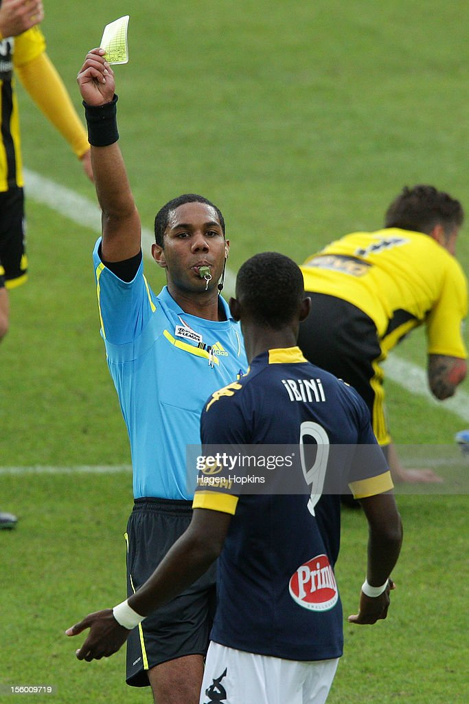 Referee Lucien Laverdure shows Bernie Ibini of the Mariners a yellow card during the round six A-League match between the Wellington Phoenix and the Central Coast Mariners at Westpac Stadium on November 11, 2012 in Wellington, New Zealand.