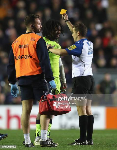 Referee Luke Pearce ishows Marland Yarde of Sale Sharks a yellow card during the Aviva Premiership match between Leicester Tigers and Sale Sharks at...