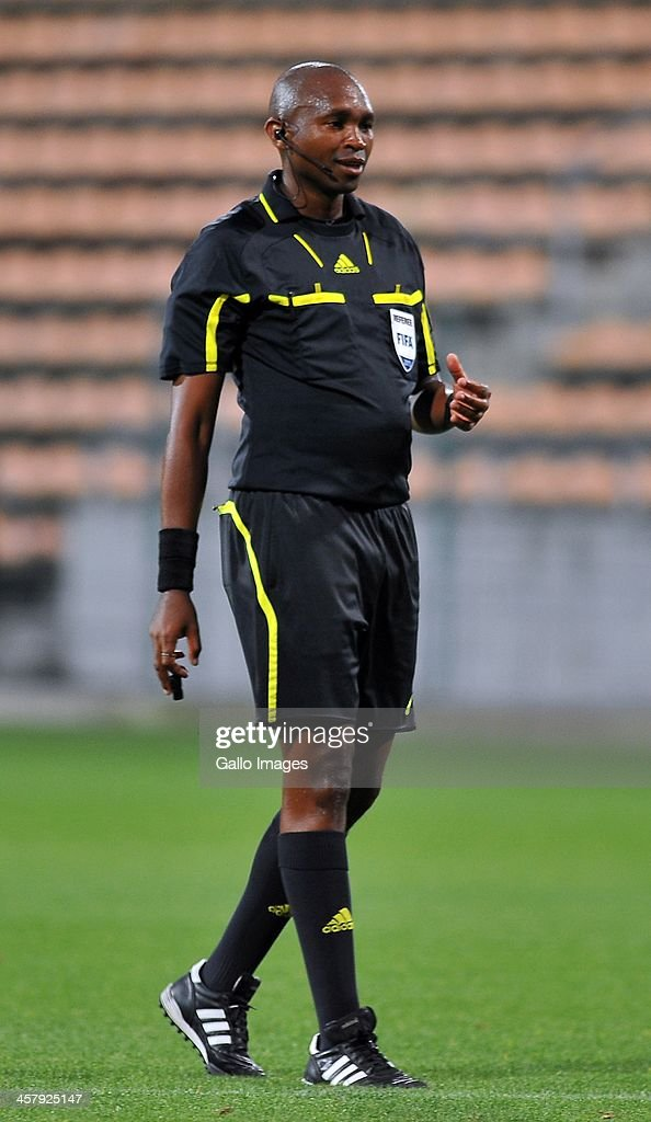 Referee Lwandile Mfiki looks on during the National First Division Qualification match between Santos and Chippa United at Athlone Stadium on December 18, 2013 in Cape Town, South Africa.