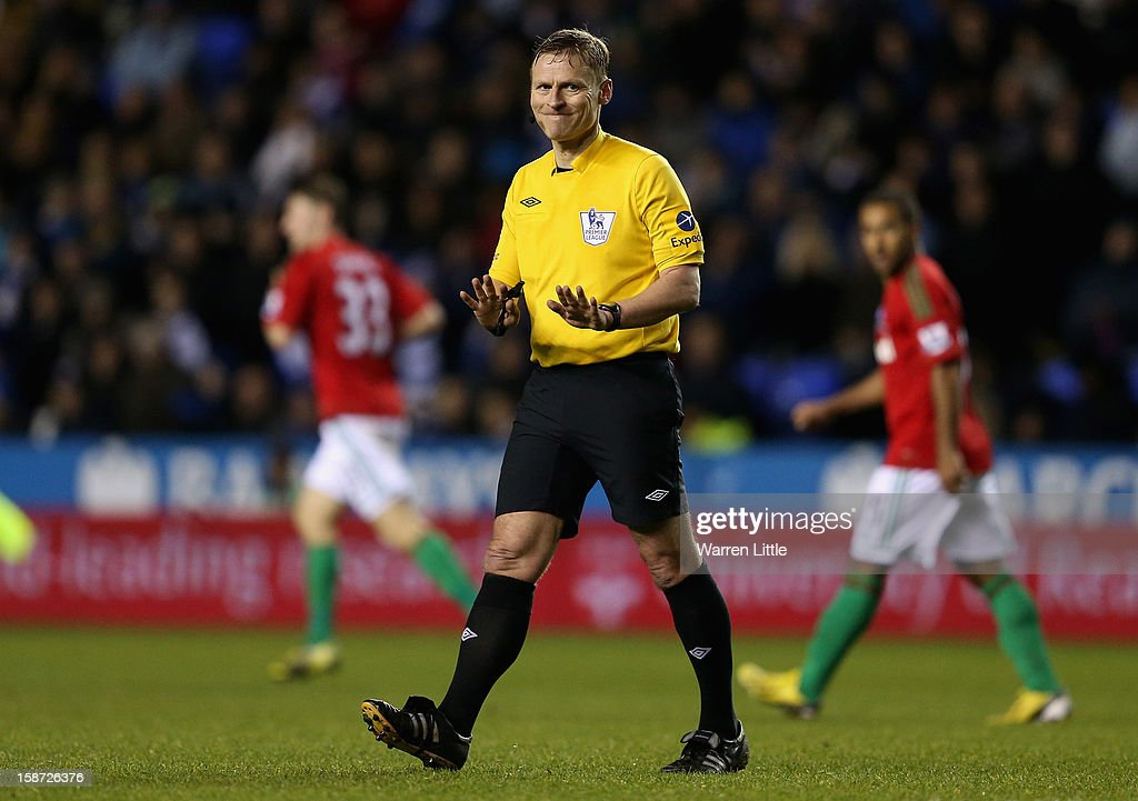 Referee, M. Jones gestures during the Barclays Premier League match between Reading and Swansea City at Madejski Stadium on December 26, 2012 in Reading, England.