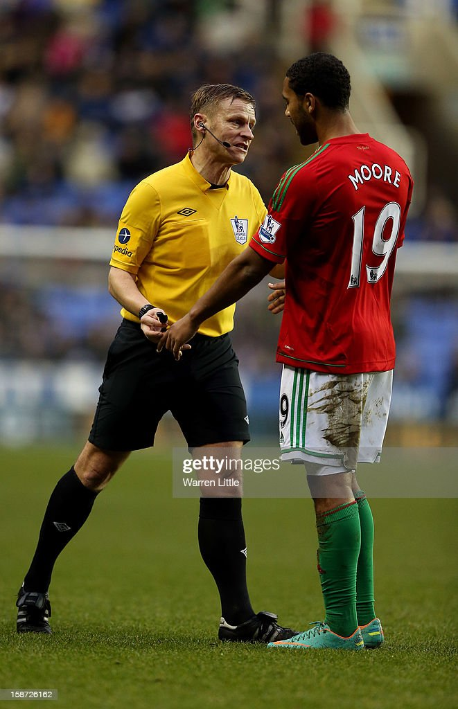 Referee M. Jones speaks with <a gi-track='captionPersonalityLinkClicked' href=/galleries/search?phrase=Luke+Moore&family=editorial&specificpeople=211020 ng-click='$event.stopPropagation()'>Luke Moore</a> of Swansea City during the Barclays Premier League match between Reading and Swansea City at Madejski Stadium on December 26, 2012 in Reading, England.