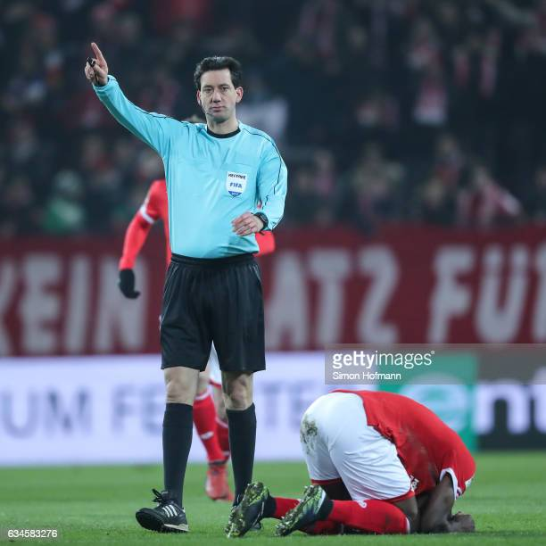 Referee Manuel Graefe gestures during the Bundesliga match between 1 FSV Mainz 05 and FC Augsburg at Opel Arena on February 10 2017 in Mainz Germany