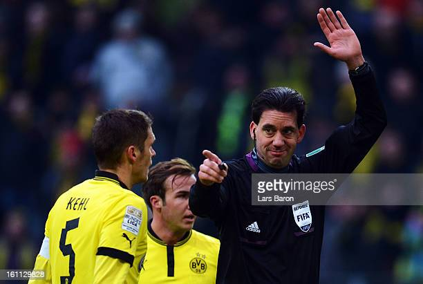 Referee Manuel Graefe gestures during the Bundesliga match between Borussia Dortmund and Hamburger SV at Signal Iduna Park on February 9 2013 in...