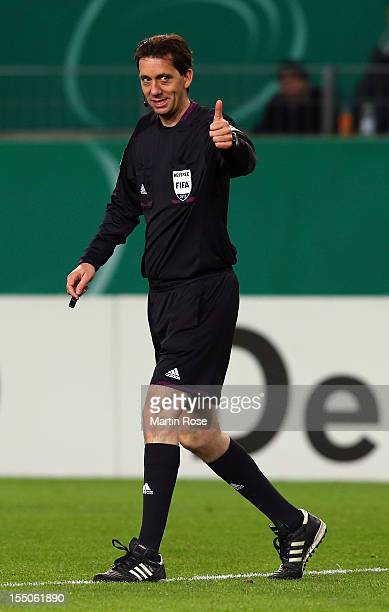 Referee Manuel Graefe gestures during the DFB Cup second round match between VfL Wolfsburg and FSV Frankfurt at Volkswagen Arena on October 31 2012...