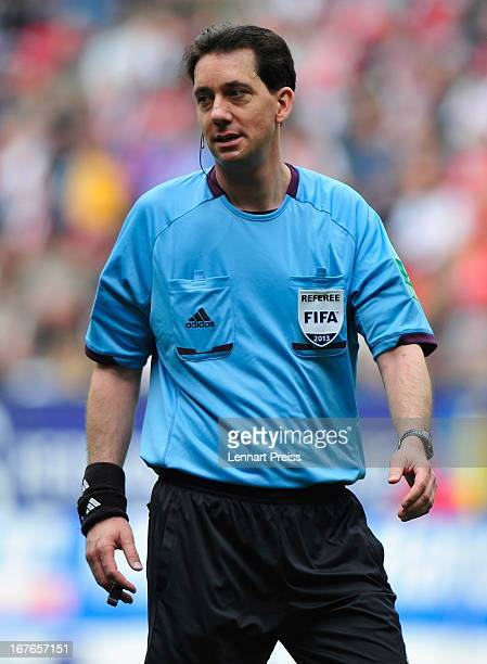 Referee Manuel Graefe reacts during the Bundesliga match between FC Augsburg and VfB Stuttgart at SGL Arena on April 27 2013 in Augsburg Germany
