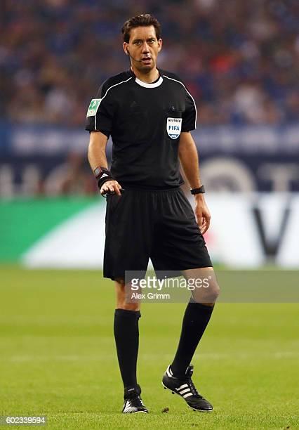 Referee Manuel Graefe reacts during the Bundesliga match between FC Schalke 04 and Bayern Muenchen at VeltinsArena on September 9 2016 in...