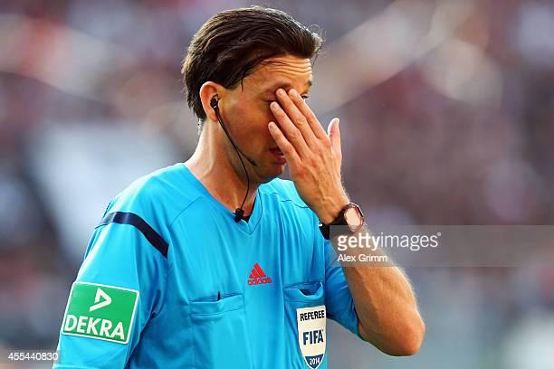 Referee Manuel Graefe reacts during the Bundesliga match between Eintracht Frankfurt and FC Augsburg at CommerzbankArena on September 14 2014 in...