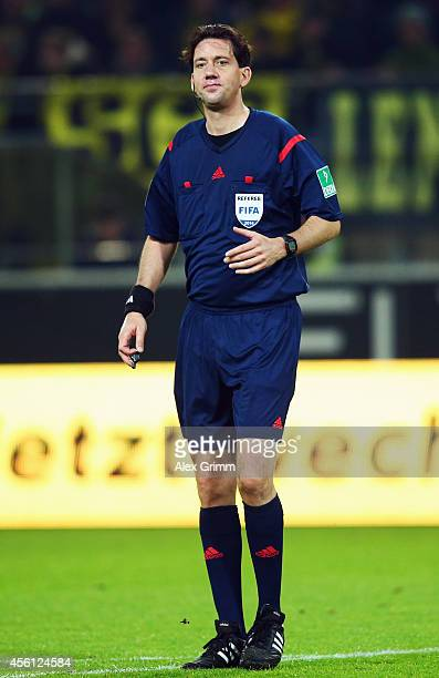 Referee Manuel Graefe reacts during the Bundesliga match between Borussia Dortmund and VfB Stuttgart at Signal Iduna Park on September 24 2014 in...
