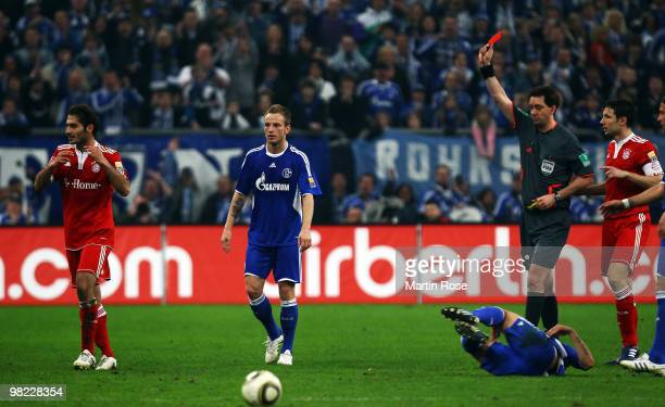 Referee Manuel Graefe shows Hamit Altintop of Muenchen the yellow red card during the Bundesliga match between FC Schalke 04 and FC Bayern Muenchen...
