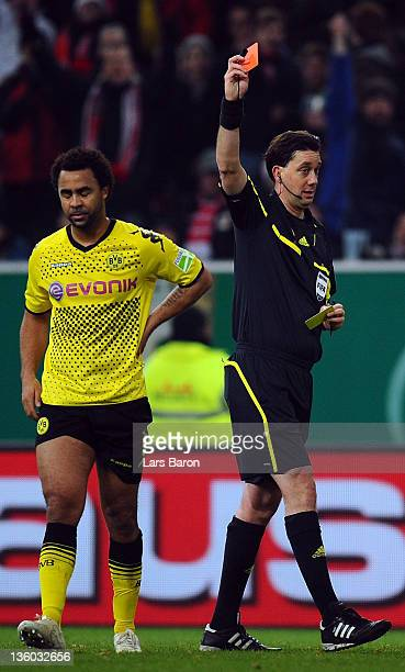 Referee Manuel Graefe shows Patrick Owomoyela of Dortmund the red card during the DFB Cup round of sixteen match between Fortuna Duesseldorf and...