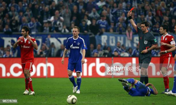 Referee Manuel Graefe shows the second yellow card to Hamit Altintop of Muenchen during the Bundesliga match between FC Schalke 04 and FC Bayern...