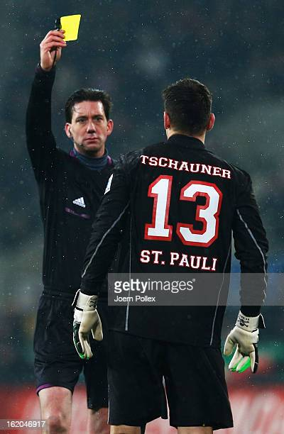Referee Manuel Graefe shows the yellow card to Philipp Tschauner of St Pauliduring the Bundesliga match between FC St Pauli and 1 FC Koeln at...