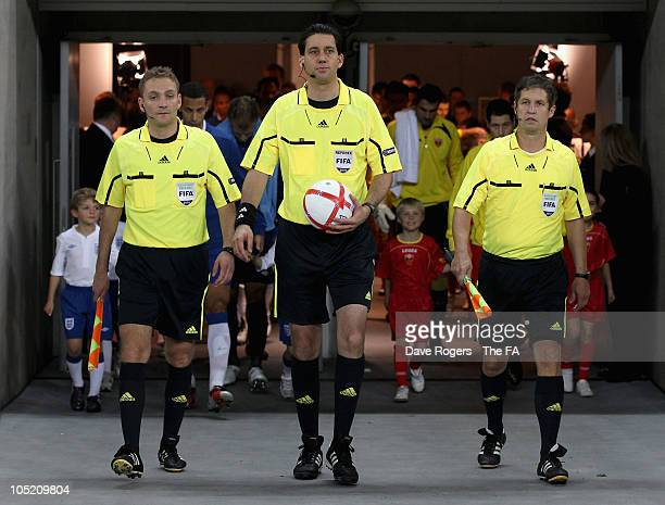 Referee Manuel Grafe assistant referees Markus Haecker and Volker Wezel walk out during the UEFA EURO 2012 Group G Qualifying match between England...