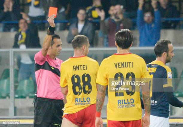 Referee Marco Di Bello shows red card to Luca Antei Benevento Calcio during the Serie A match between Hellas Verona FC and Benevento Calcio at Stadio...