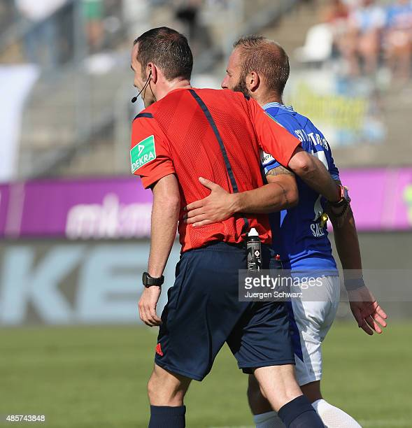 Referee Marco Fritz hugs Marco Sailer of Darmstadt during the Bundesliga match between SV Darmstadt 98 and 1899 Hoffenheim at MerckStadion am...