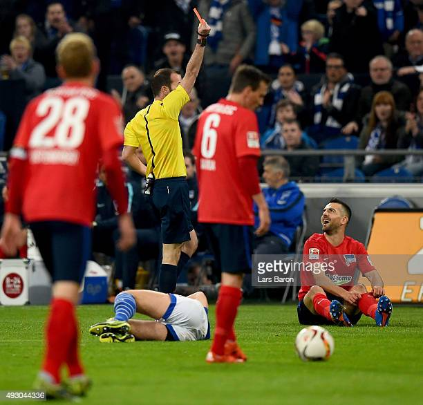 Referee Marco Fritz shows Vedad Ibisevic of Berlin the red card during the Bundesliga match between FC Schalke 04 and Hertha BSC Berlin at...