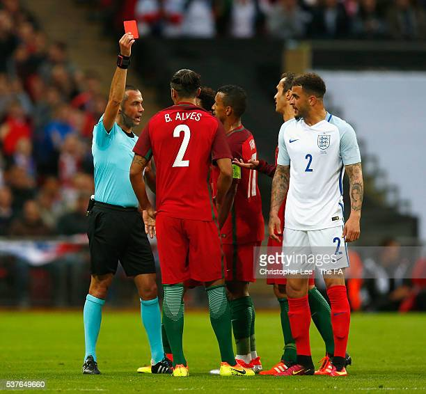 Referee Marco Guida shows the red card to Bruno Alves of Portugal after his challenge on Harry Kane of England during the International Friendly...
