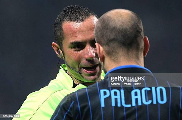 Referee Marco Guida speaks to Rodrigo Palacio of FC Internazionale Milano during the Serie A match between AC Milan and FC Internazionale Milano at...