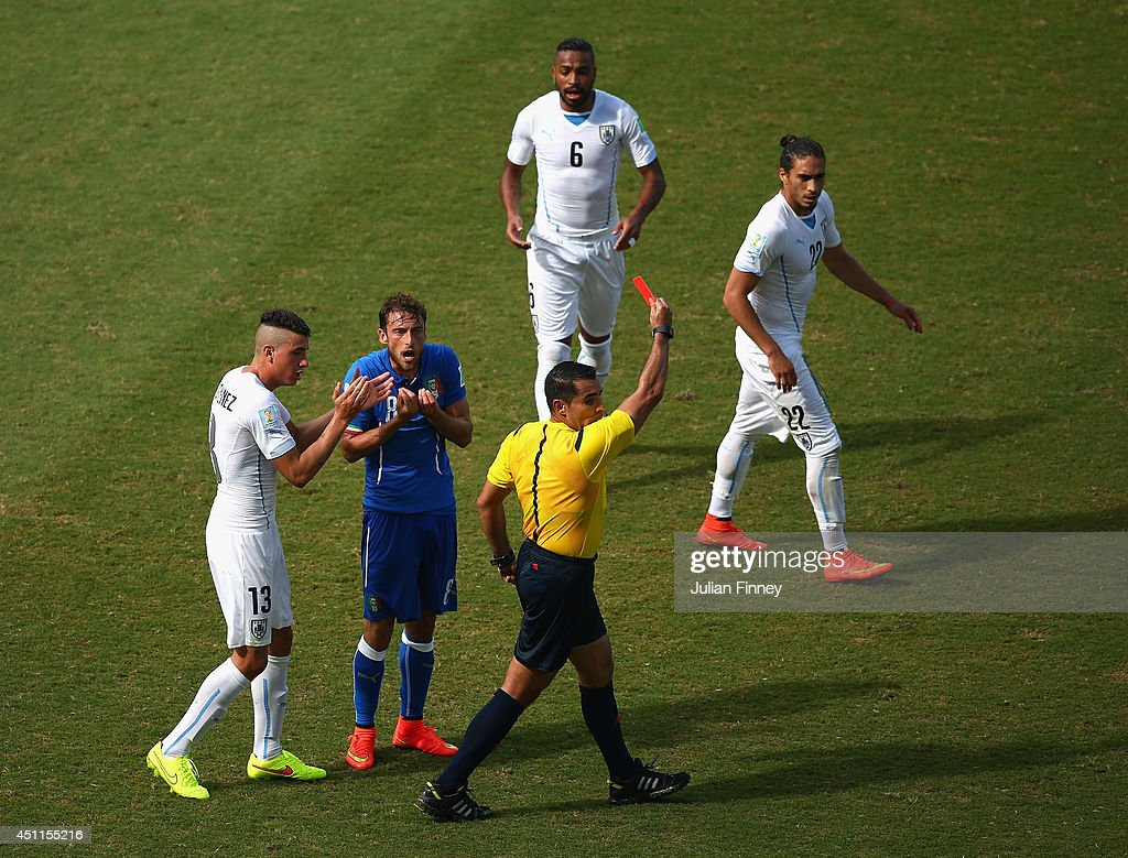 Referee <a gi-track='captionPersonalityLinkClicked' href=/galleries/search?phrase=Marco+Rodriguez+-+Referee&family=editorial&specificpeople=12960306 ng-click='$event.stopPropagation()'>Marco Rodriguez</a> shows a red card to <a gi-track='captionPersonalityLinkClicked' href=/galleries/search?phrase=Claudio+Marchisio&family=editorial&specificpeople=4604252 ng-click='$event.stopPropagation()'>Claudio Marchisio</a> of Italy during the 2014 FIFA World Cup Brazil Group D match between Italy and Uruguay at Estadio das Dunas on June 24, 2014 in Natal, Brazil.