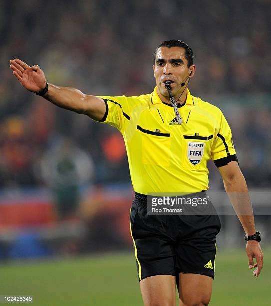 Referee Marco Rodriquez of Mexico signals during the 2010 FIFA World Cup South Africa Group H match between Chile and Spain at Loftus Versfeld...