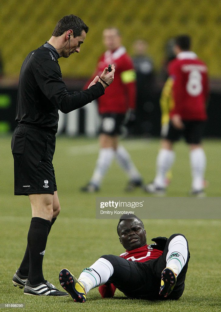 Referee Marijo Strahonja speaks to Didier Ya Konan of Hannover 96 during the UEFA Europa League Round of 32 first leg match between FC Anji Makhachkala and Hannover 96 at the Luzhniki Stadium on February 14, 2013 in Moscow, Russia.