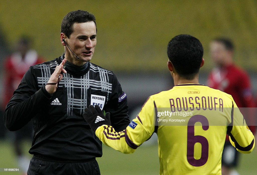 Referee Marijo Strahonja speaks to Mbark Boussoufa of FC Anji Makhachkala during the UEFA Europa League Round of 32 first leg match between FC Anji Makhachkala and Hannover 96 at the Luzhniki Stadium on February 14, 2013 in Moscow, Russia.