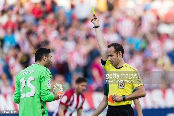 Referee Mario Melero lopez shows a yellow card for Salvatore Sirigu goalkeeper of Osasuna during the La Liga match between Atletico de Madrid vs...