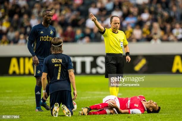 Referee Marius Avram awards a free kick for a foul on Danilo Barbosa da Silva of SC Braga during a UEFA Europa League qualification match between AIK...