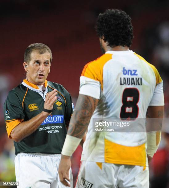 Referee Marius Jonker speaks to Sione Lauaki of Chiefs during the Super 14 match between Auto and General Lions and Chiefs from CocaCola Park on...
