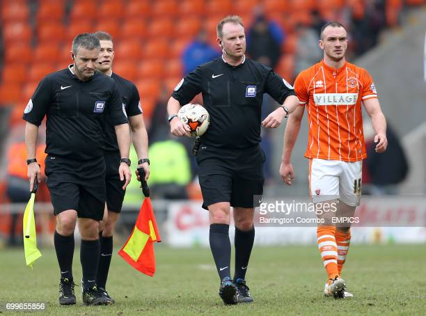 Referee Mark Brown and Blackpool's Tom Aldred