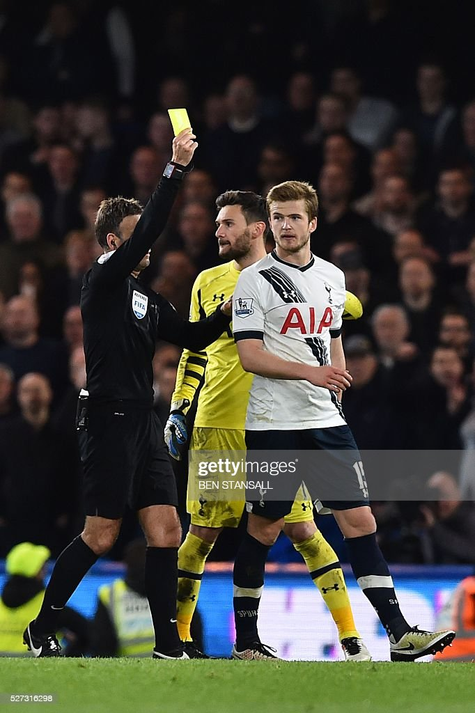 Referee Mark Clatenburg (L) shows Tottenham Hotspur's English defender Eric Dier (R) a yellow card during the English Premier League football match between Chelsea and Tottenham Hotspur at Stamford Bridge in London on May 2, 2016. / AFP / BEN STANSALL / RESTRICTED TO EDITORIAL USE. No use with unauthorized audio, video, data, fixture lists, club/league logos or 'live' services. Online in-match use limited to 75 images, no video emulation. No use in betting, games or single club/league/player publications. /