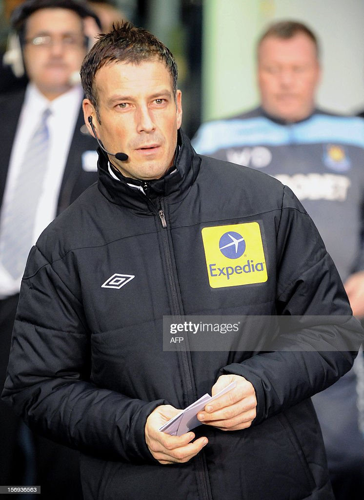 """Referee Mark Clattenburg, 4th official, attends the English Premier League football match between Tottenham Hotspurs and West Ham at White Hart Lane in North London on November 25, 2012. Clattenburg made his return as the fourth official at White Hart Lane, in his first engagement since he was cleared by the Football Association over allegations he racially abused Chelsea midfielder John Obi Mikel. USE. No use with unauthorized audio, video, data, fixture lists, club/league logos or """"live"""" services. Online in-match use limited to 45 images, no video emulation. No use in betting, games or single club/league/player publications."""