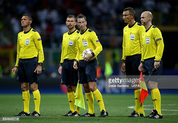 Referee Mark Clattenburg and match officials are seen during the UEFA Champions League Final between Real Madrid and Club Atletico de Madrid at...