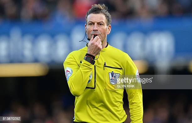 Referee Mark Clattenburg blows the whistle during the English Premier League football match between Chelsea and Stoke City at Stamford Bridge in...