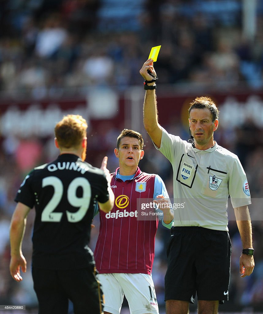 Referee <a gi-track='captionPersonalityLinkClicked' href=/galleries/search?phrase=Mark+Clattenburg&family=editorial&specificpeople=2108870 ng-click='$event.stopPropagation()'>Mark Clattenburg</a> brandishes a yellow card to Hull City player Stephen Quinn during the Barclays Premier League match between Aston Villa and Hull City at Villa Park on August 31, 2014 in Birmingham, England.