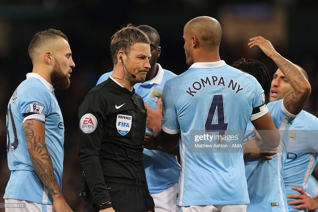 Referee Mark Clattenburg dismisses appeals from Vincent Kompany of Manchester City after awarding a penalty during the Barclays Premier League match between Manchester City and Tottenham Hotspur at the Etihad Stadium Bloomfield Road on February 14, 2016 in Manchester, England.