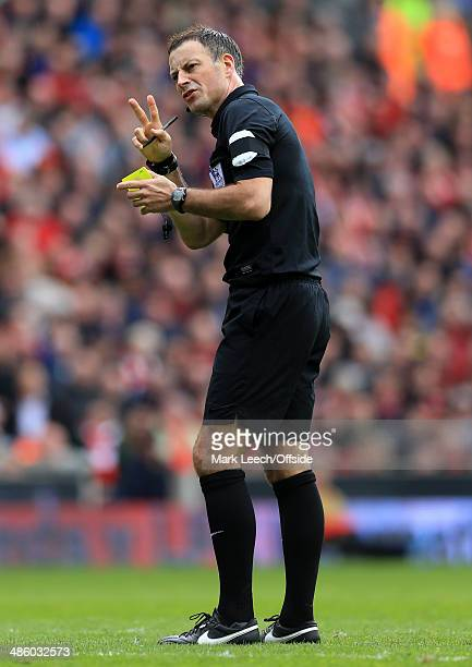 Referee Mark Clattenburg gestures during the Barclays Premier League match between Liverpool and Manchester City at Anfield on April 13 2014 in...