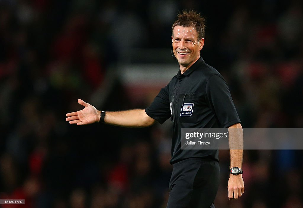 Referee Mark Clattenburg gestures during the Capital One Cup Third Round match betwen Manchester United and Liverpool at Old Trafford on September 25, 2013 in Manchester, England.