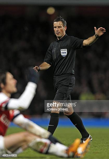 Referee Mark Clattenburg gestures during the English FA cup third round football match between Arsenal and Tottenham Hotspur at the Emirates Stadium...