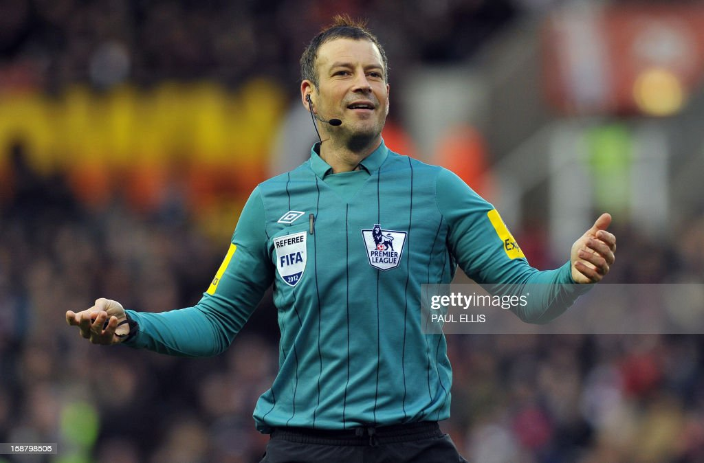 "Referee Mark Clattenburg gestures during the English Premier League football match between Stoke City and Southampton at The Britannia stadium, Stoke-on-Trent, England, on December 29, 2012. The game ended 3-3. USE. No use with unauthorized audio, video, data, fixture lists, club/league logos or ""live"" services. Online in-match use limited to 45 images, no video emulation. No use in betting, games or single club/league/player publications."