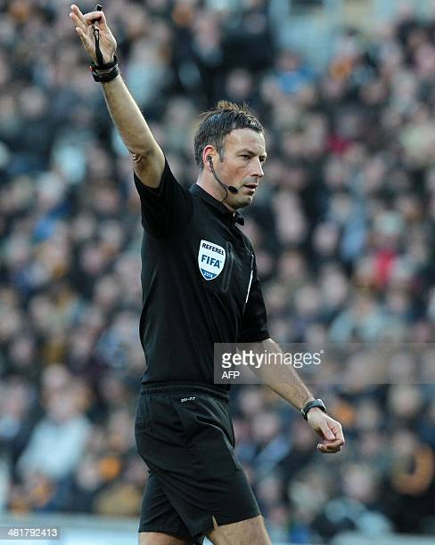 Referee Mark Clattenburg gestures during the English Premier League football match between Hull City and Chelsea at The KC Stadium in Hull on January...