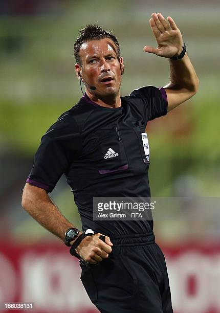 Referee Mark Clattenburg gestures during the FIFA U17 World Cup UAE 2013 Group E match between Argentina and Canada at Al Rashid Stadium on October...