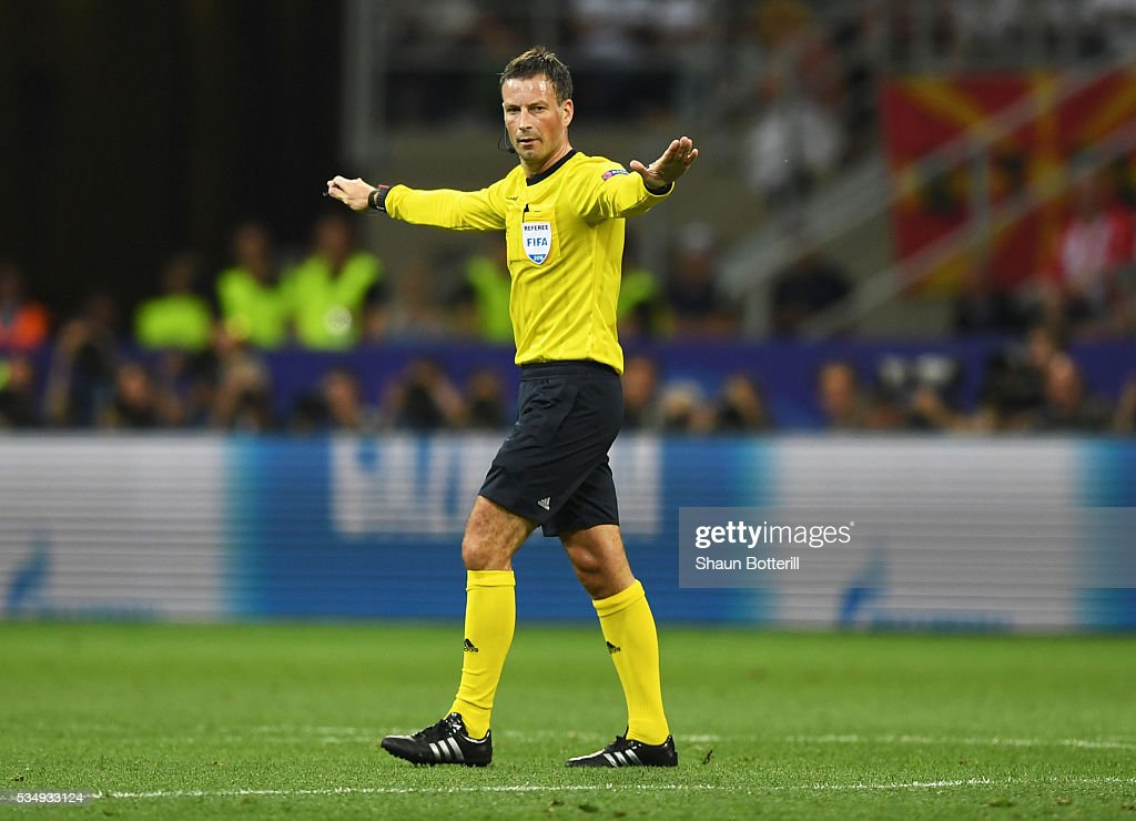 Referee <a gi-track='captionPersonalityLinkClicked' href=/galleries/search?phrase=Mark+Clattenburg&family=editorial&specificpeople=2108870 ng-click='$event.stopPropagation()'>Mark Clattenburg</a> gestures during the UEFA Champions League Final match between Real Madrid and Club Atletico de Madrid at Stadio Giuseppe Meazza on May 28, 2016 in Milan, Italy.