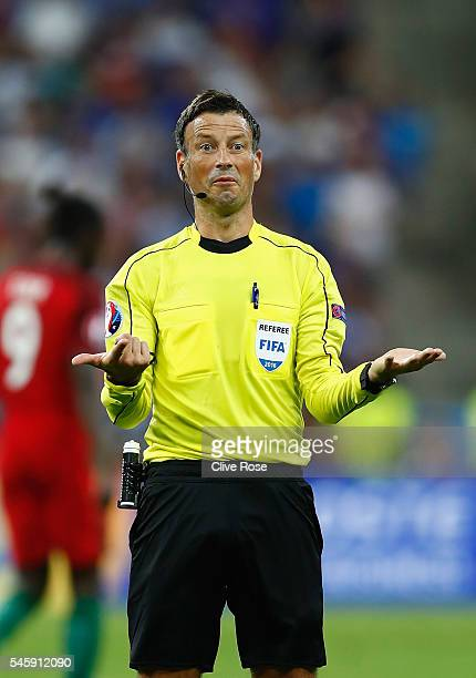 Referee Mark Clattenburg gestures during the UEFA EURO 2016 Final match between Portugal and France at Stade de France on July 10 2016 in Paris France