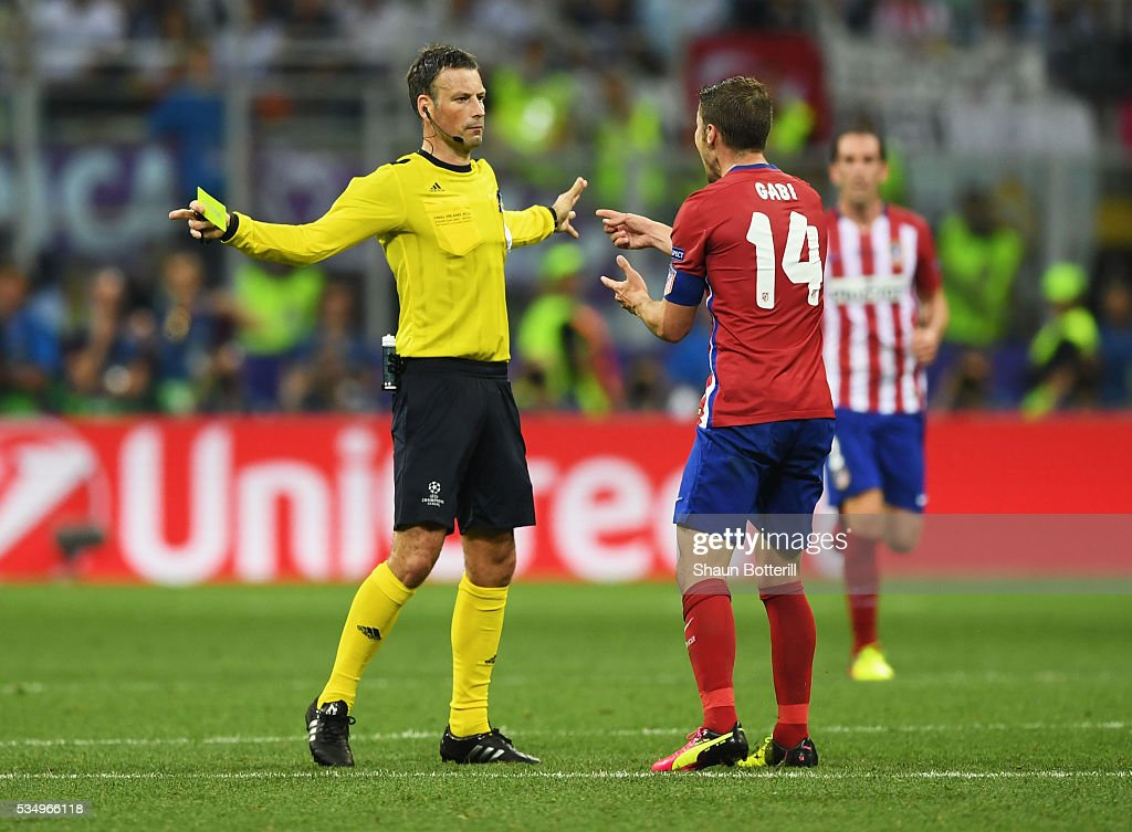 Referee <a gi-track='captionPersonalityLinkClicked' href=/galleries/search?phrase=Mark+Clattenburg&family=editorial&specificpeople=2108870 ng-click='$event.stopPropagation()'>Mark Clattenburg</a> gestures towards <a gi-track='captionPersonalityLinkClicked' href=/galleries/search?phrase=Gabi+-+Soccer+Player&family=editorial&specificpeople=6912055 ng-click='$event.stopPropagation()'>Gabi</a> of Atletico Madrid as he complains about a decision during the UEFA Champions League Final match between Real Madrid and Club Atletico de Madrid at Stadio Giuseppe Meazza on May 28, 2016 in Milan, Italy.