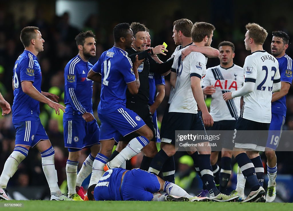 Referee Mark Clattenburg gets caught up in the melee as Eden Hazard of Chelsea lies injured during the Barclays Premier League match between Chelsea and Tottenham Hotspur at Stamford Bridge on May 2, 2016 in London, England.