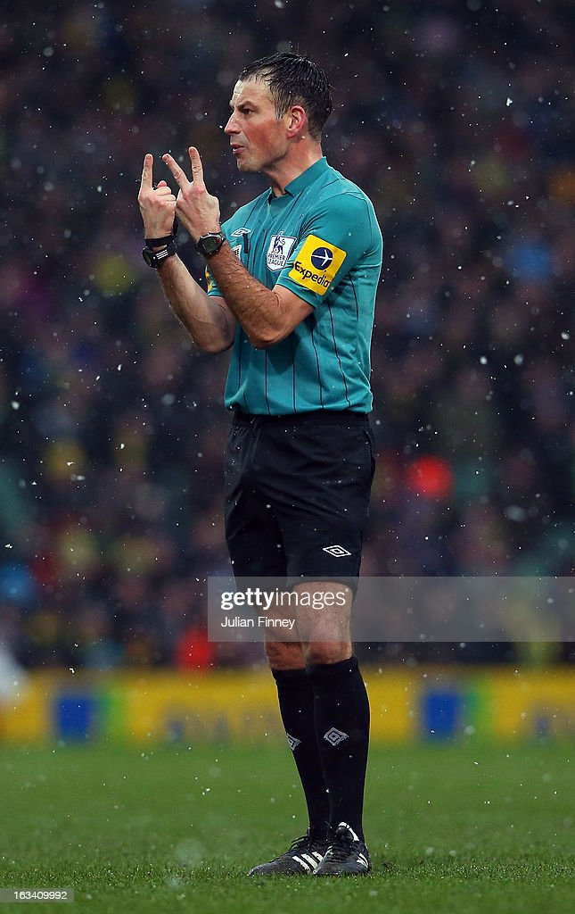 Referee, Mark Clattenburg gives a decision during the Barclays Premier League match between Norwich City and Southampton at Carrow Road on March 9, 2013 in Norwich, England.