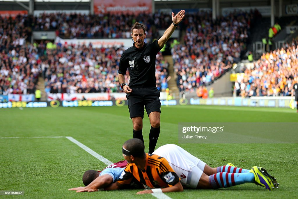 Referee Mark Clattenburg gives a free kick as Liam Rosenior of Hull brings down Gabriel Agbonlahor of Aston Villa during the Barclays Premier League match between Hull City and Aston Villa at KC Stadium on October 5, 2013 in Hull, England.