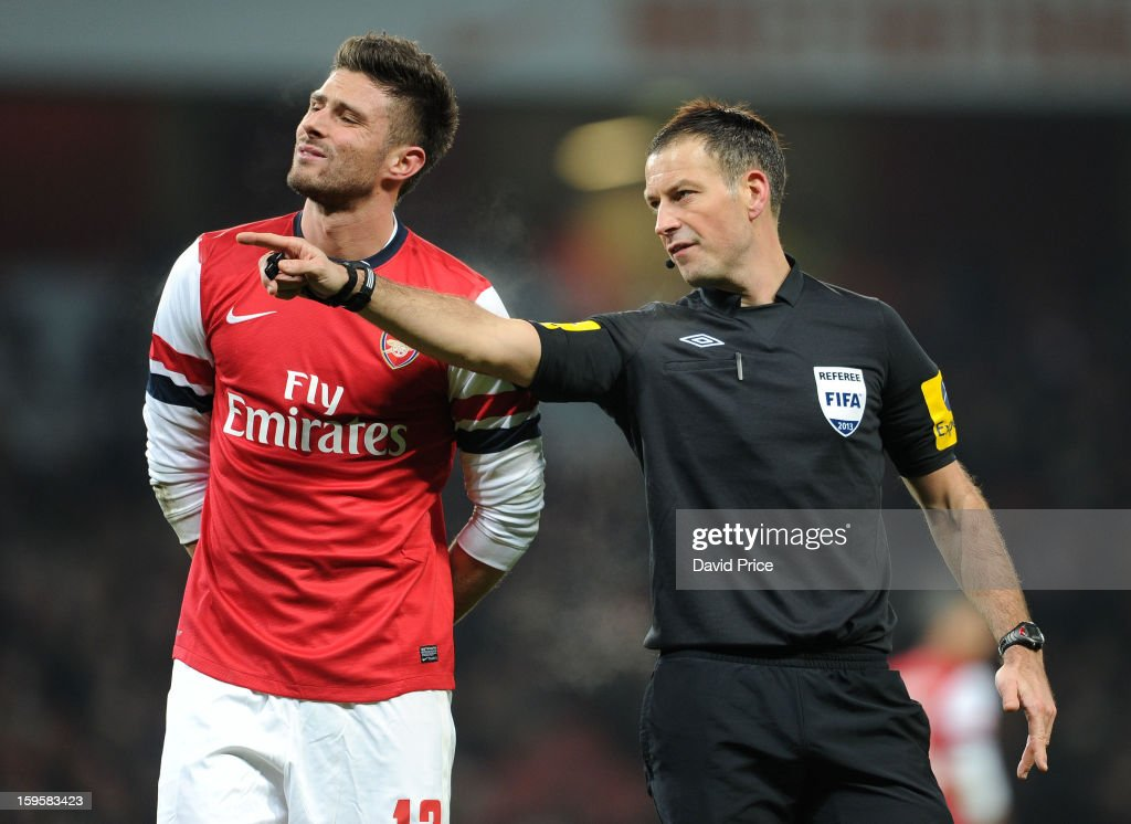 Referee Mark Clattenberg has a word with <a gi-track='captionPersonalityLinkClicked' href=/galleries/search?phrase=Olivier+Giroud&family=editorial&specificpeople=5678034 ng-click='$event.stopPropagation()'>Olivier Giroud</a> of Arsenal during the FA Cup Third Round Replay match between Arsenal and Swansea City at the Emirates Stadium on January 16, 2013 in London, England.